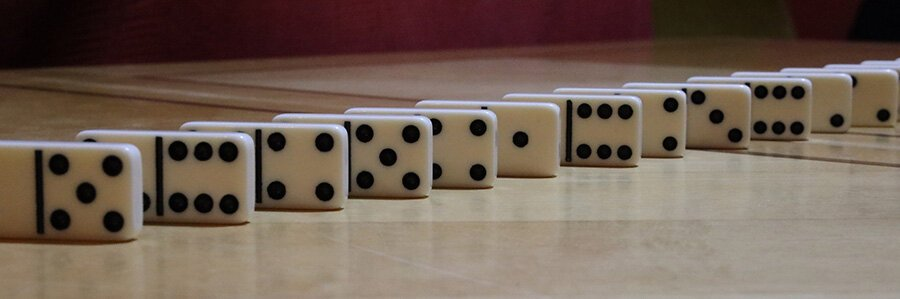 Depth of field examples. Dominoes spaced at 2cm intervals were shot with a 70mm focal length lens at an f-stop of f/22. We see that all the dominoes appear to be in focus