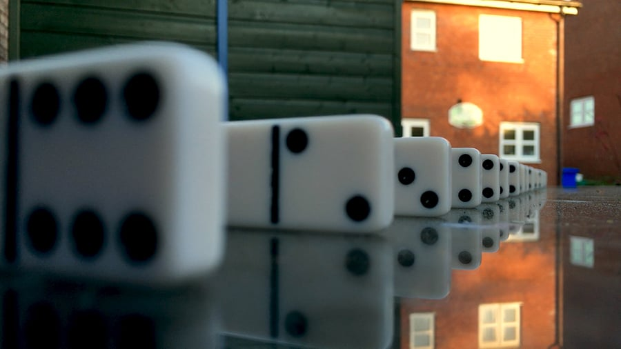 Demonstrating depth of field with iPhone using dominoes. The iPhone camera is focused on a domino 8 inches away, producing a wider depth of field. Consequently the background is less blurry.