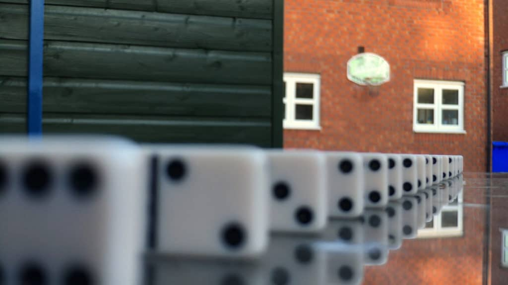 Demonstrating depth of field with iPhone using dominoes. The iPhone camera is focused on a domino 24 inches away.