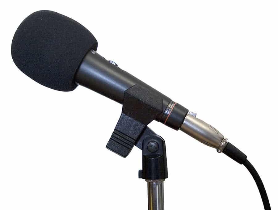 Foam or sponge pop filter on a microphone. Attribution: Zzubnik [Public domain]