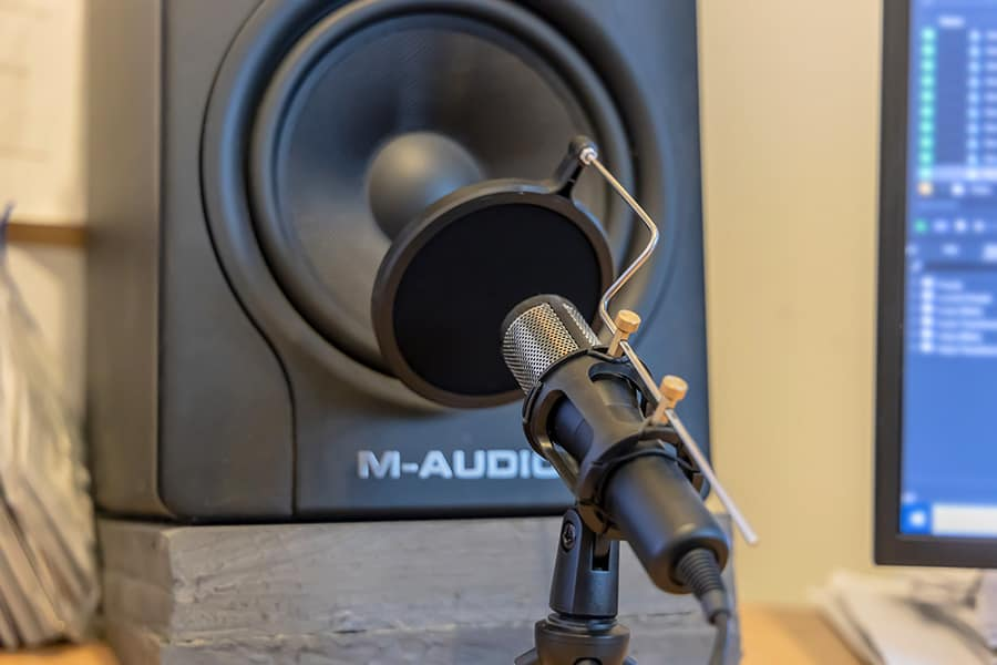 Get your microphone close to the loudspeaker