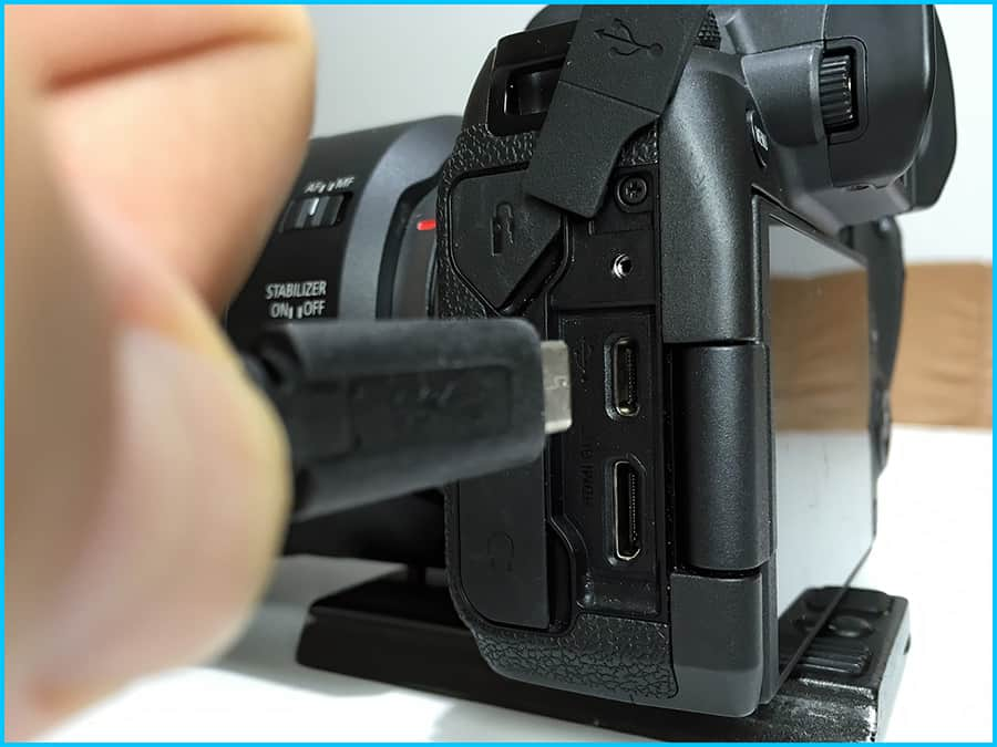USB-C cable connected to the USB port on an EOS-R