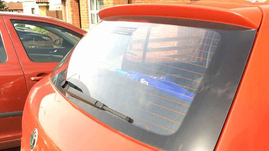 Remove glare from video clips - Example of suns glare on motor car rear window and trunk