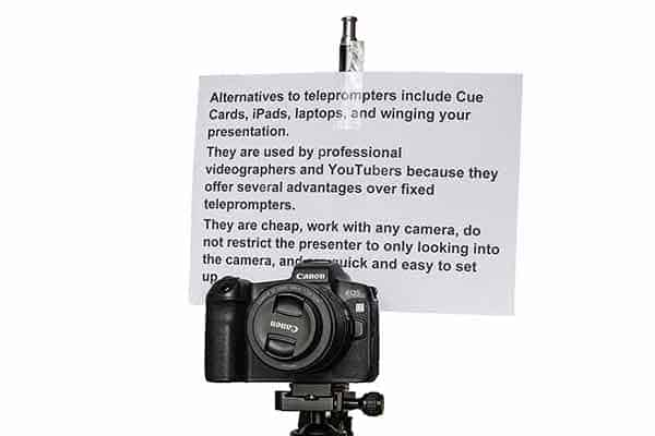 Cue card attached to light stand and placed above and behind the camera