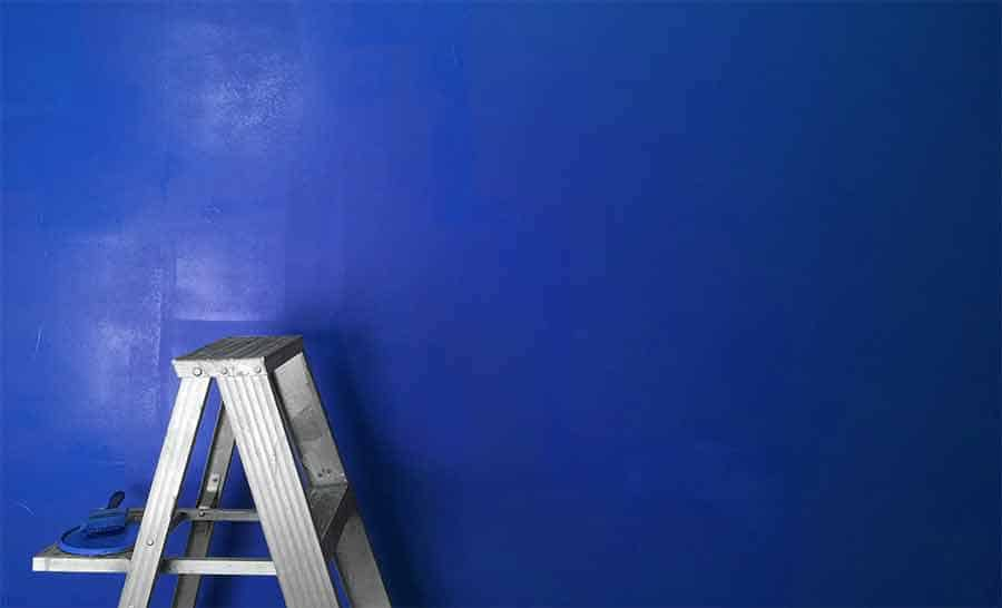 You can paint a wall either blue or green and use it as a blue or green screen