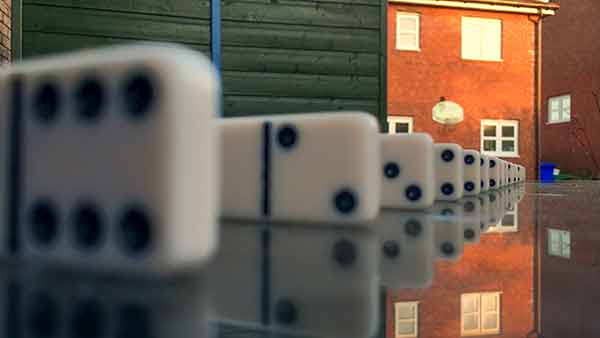 Demonstrating depth of field with iPhone using dominoes. The iPhone camera is focused on a domino 14 inches away, producing a depth of field of over 26 inches. Consequently the background is almost in focus.