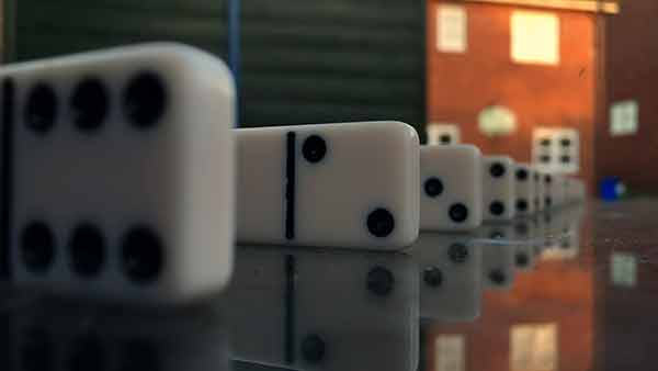 Demonstrating depth of field with iPhone using dominoes. The iPhone camera is focused on a domino 4 inches away, producing a narrow depth of field. Consequently the background is very blurry.