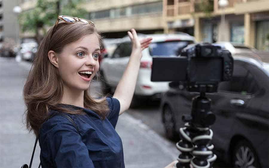 Girl vlogging is DSLR camera